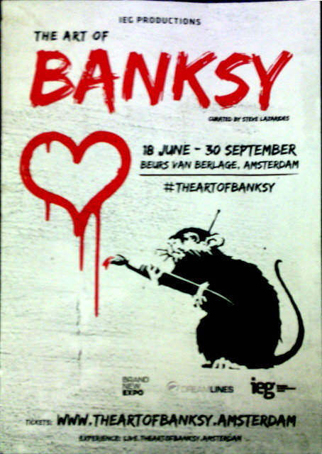 Postcard advertising the Art of Banksy show in Amsterdam